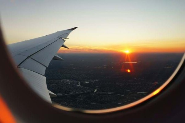 View of a sunset from an airplane window