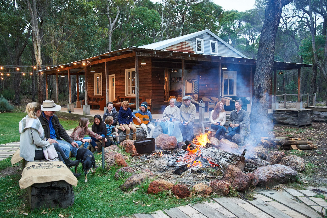 People around a campfire in winter in Australia's South West