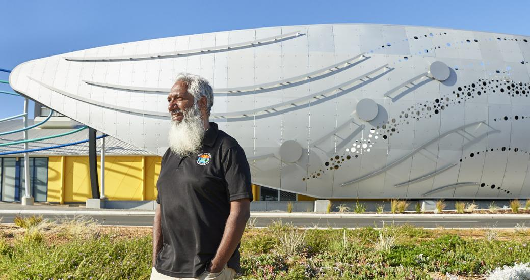 Aboriginal artist Troy Bennell standing in front of the new Dolphin Discovery Centre
