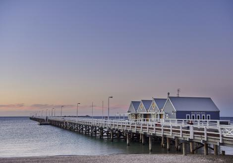 Busselton Jetty at sunset with a purple sky