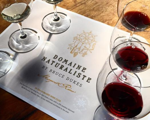 Glasses of red and white whine on a Domaine Naturaliste menu