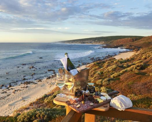 Wine and local produce hamper at the beach
