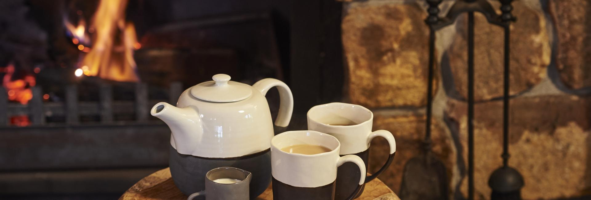 Tea pot and mugs by an open fire in Australias South West