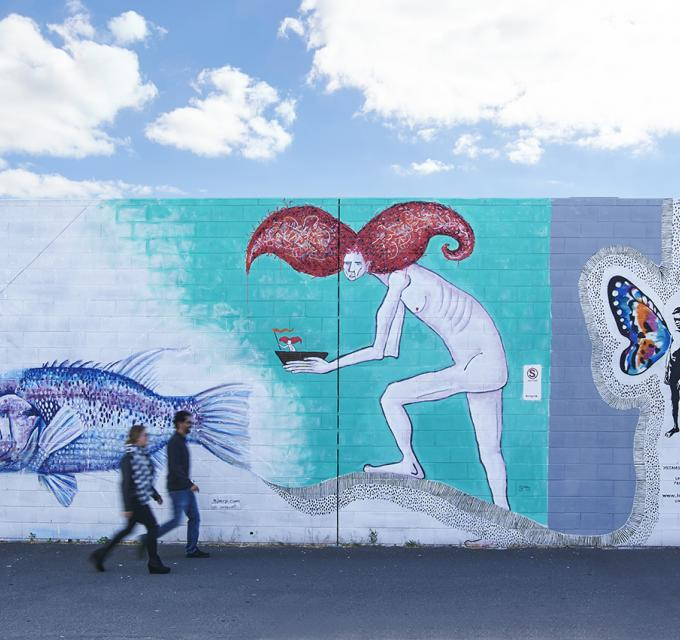 Couple walking past street art mural in Bunbury - Australias South West