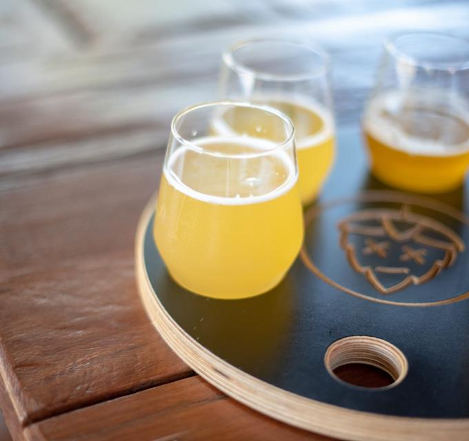 A tasting paddle of different beers